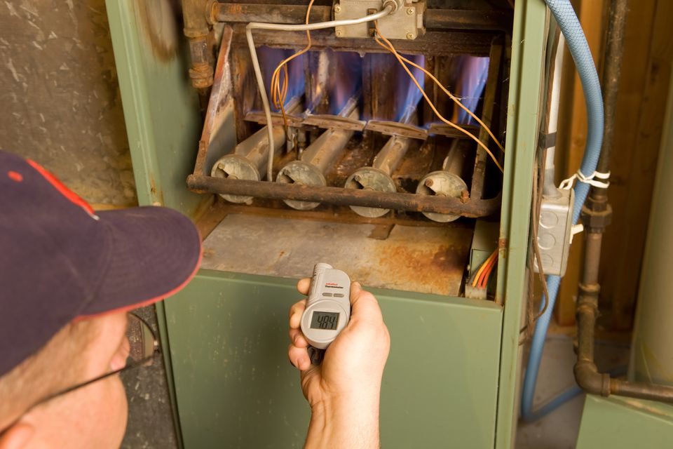 A home furnace being services