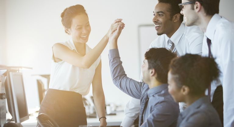 Business people cheering in an office
