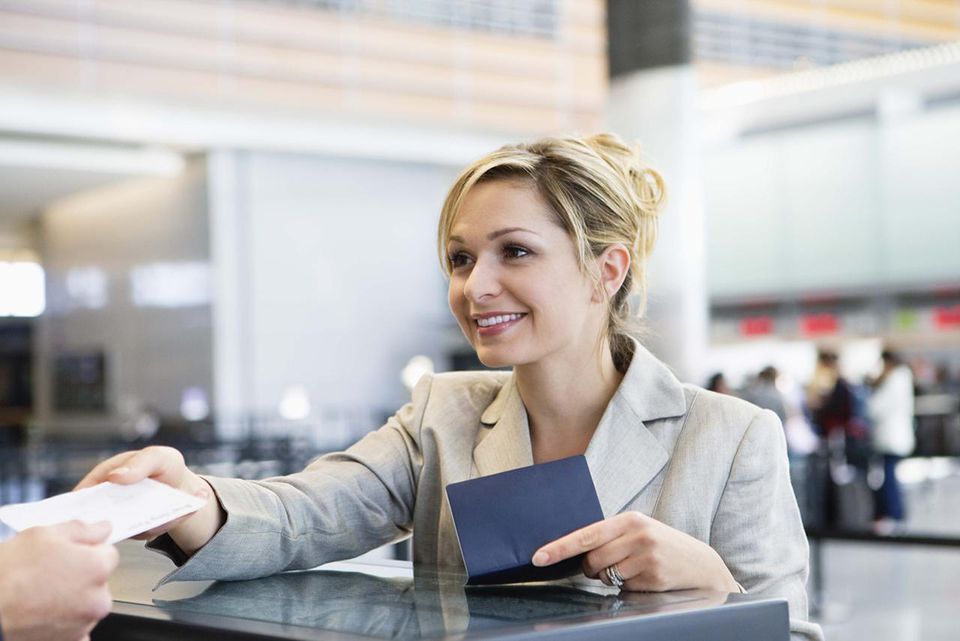 Businesswoman checking in at airport ticket counter