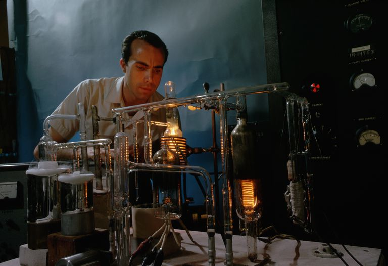 Scientist Using Furnace for Dating Process