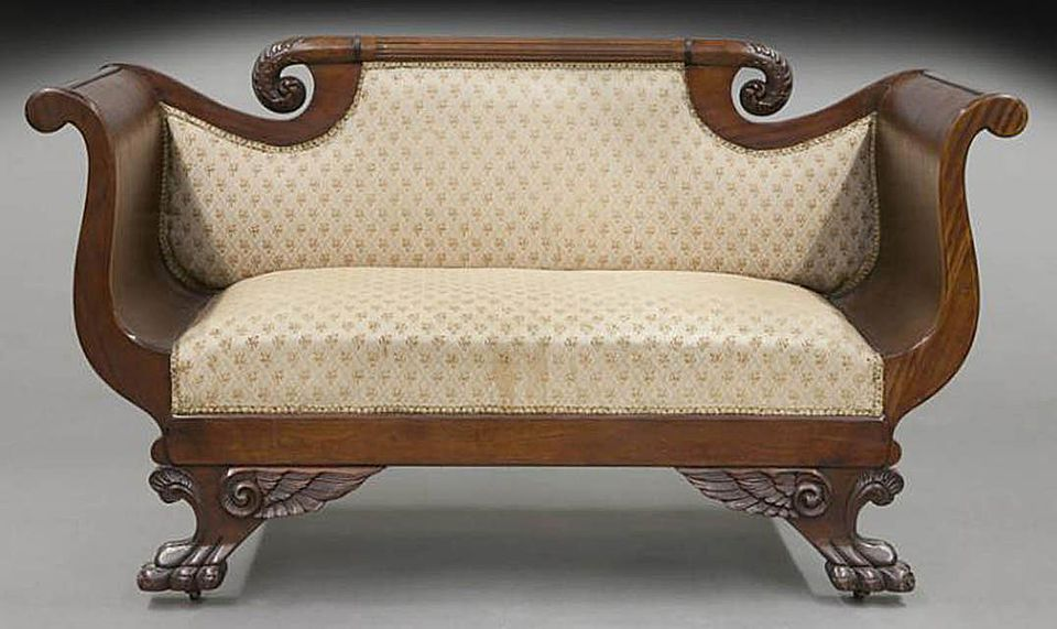 American Empire settee made of mahogany with scrolled crest & arms and winged paw feet
