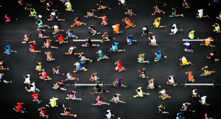 Marathon runners running on paved road