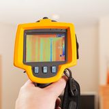 Infrared Thermal Imaging Camera Pointing to House Wall