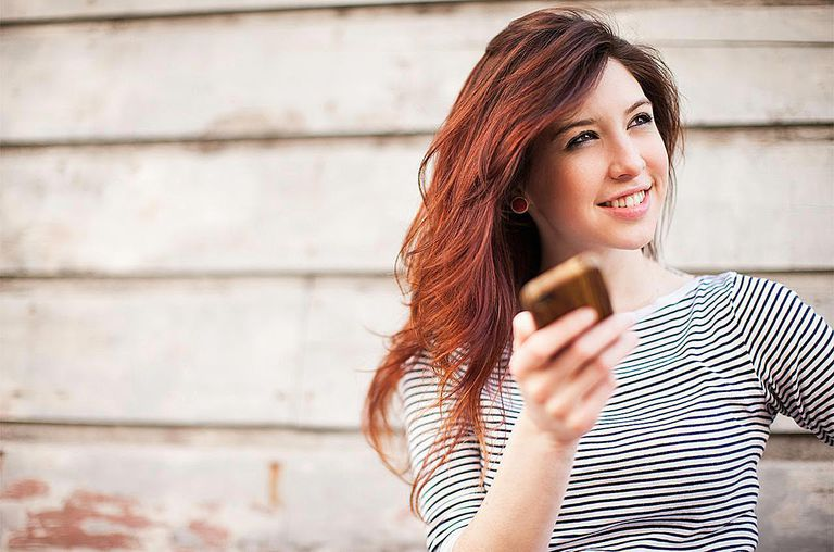 Portrait of young woman with smartphone