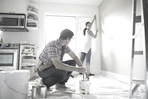 a couple painting their kitchen