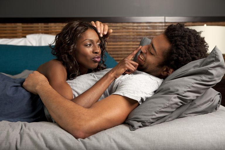 Man and woman laying in bed.