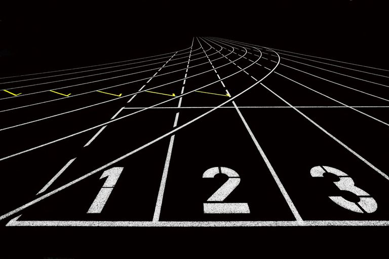 black track lanes with white and yellow