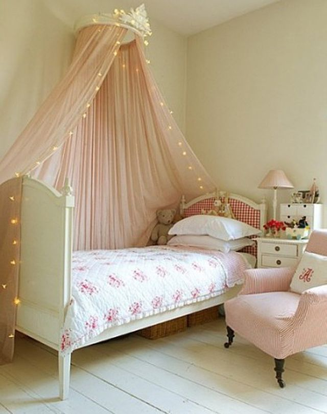 Sweet girl's room with crown canopy over bed.