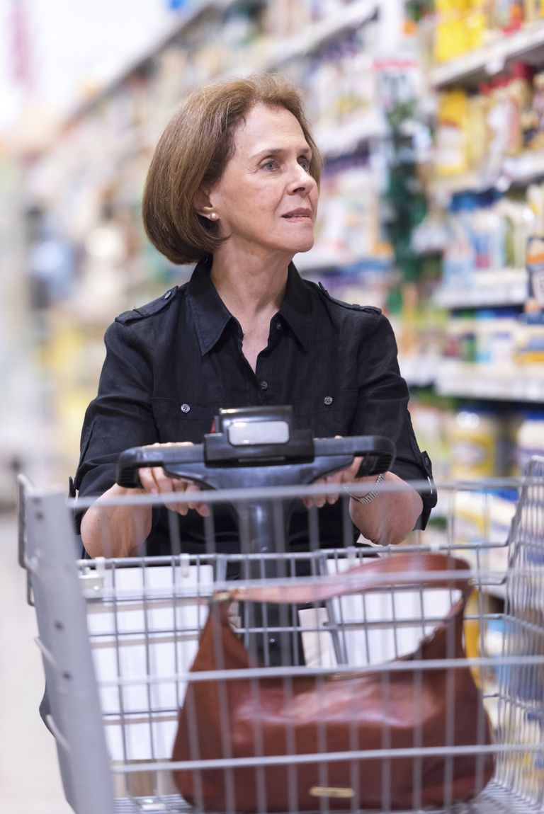 woman in electric wheelchair grocery shopping