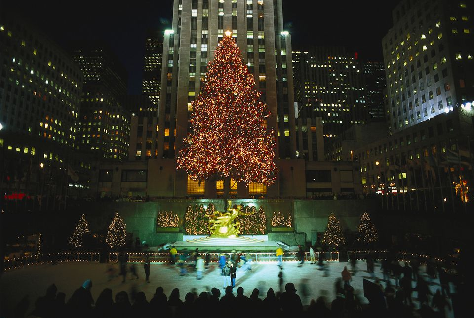 Illuminated Christmas trees at the ice skating rink at the Rockefeller Center, Manhattan, New York City, USA, America