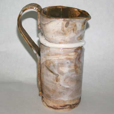 A pottery pitcher made using the slab building method.