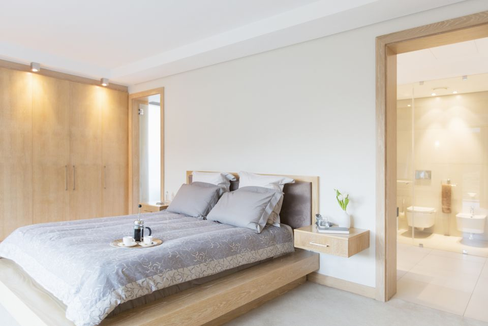 Serene bedroom with breakfast on the bed