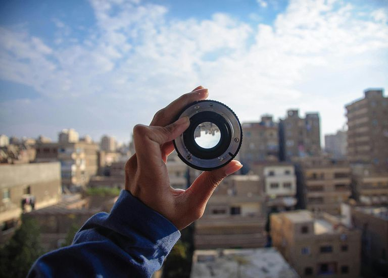 Perspective through a camera lens illustrates the concept of theoretical perspective.