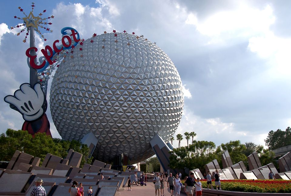 Guests leave Walt Disney World's Epcot October 8, 2003 near Orlando, Florida