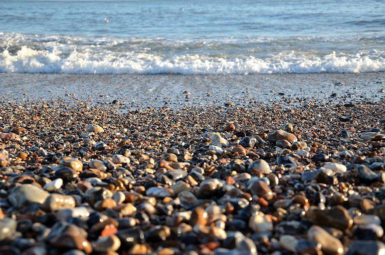 Tranquil Sunny Beach Wet pebbles