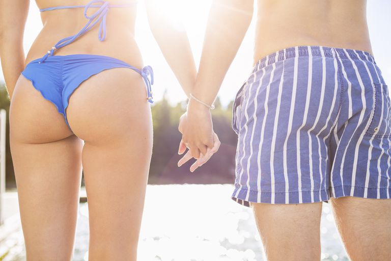 Rear view of man and woman; butt acne.