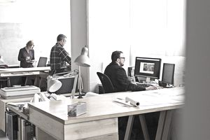 Designers at work at workstations
