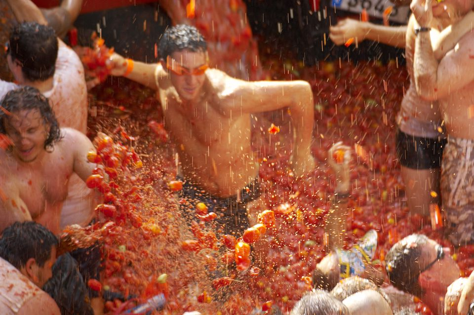 Tomato fight at La Tomatina tomato festival.