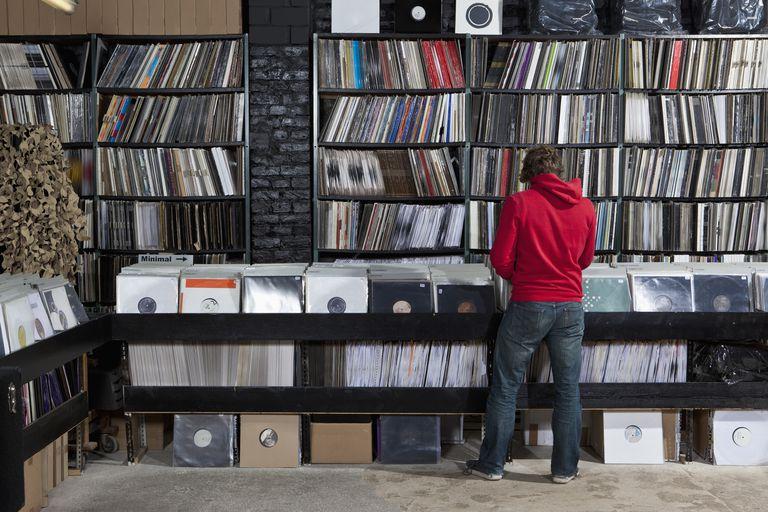 Man flipping through records