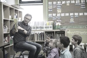 special education teacher reading to students