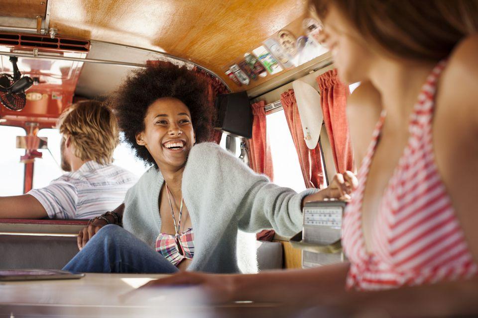 Friends relaxing in camper van
