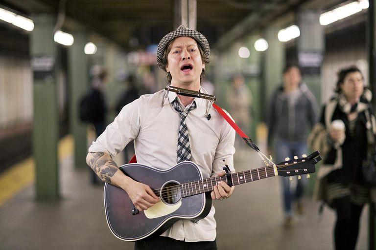 usician Performing on Subway Platform