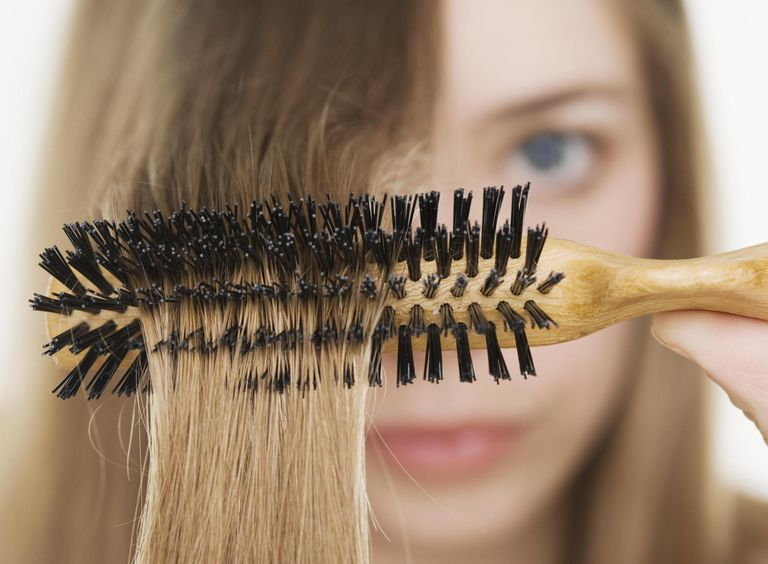 Close up of hairbrush in woman?s hair