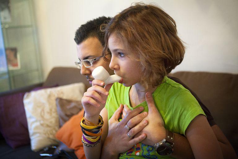 Girl using an oscillating PEP device