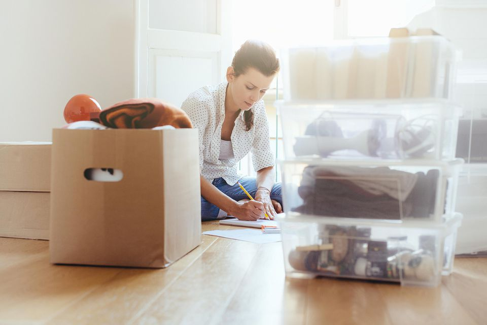 Woman packing in preparation for house move