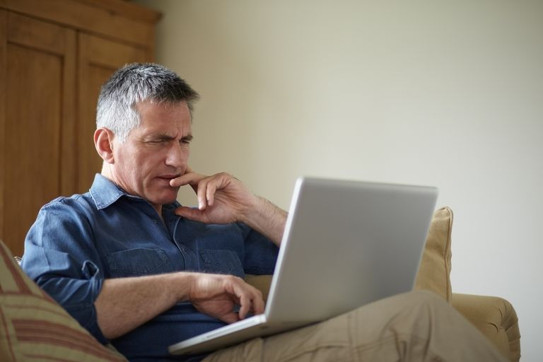 Man checking his credit score on a computer