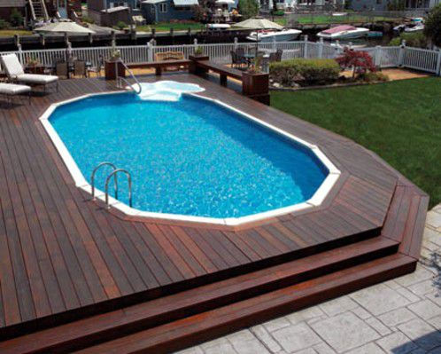 Oval shaped swimming pools designs for Above ground pool surround ideas