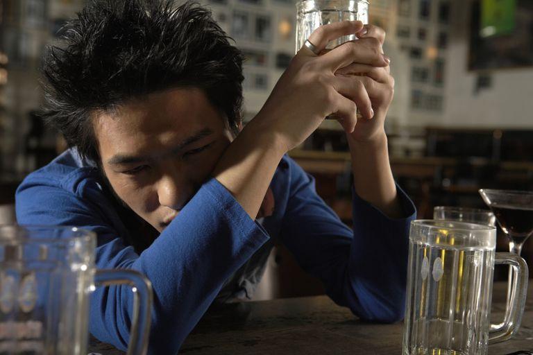 Man Drunk at Bar