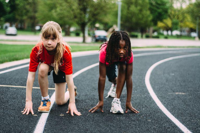Children running around track