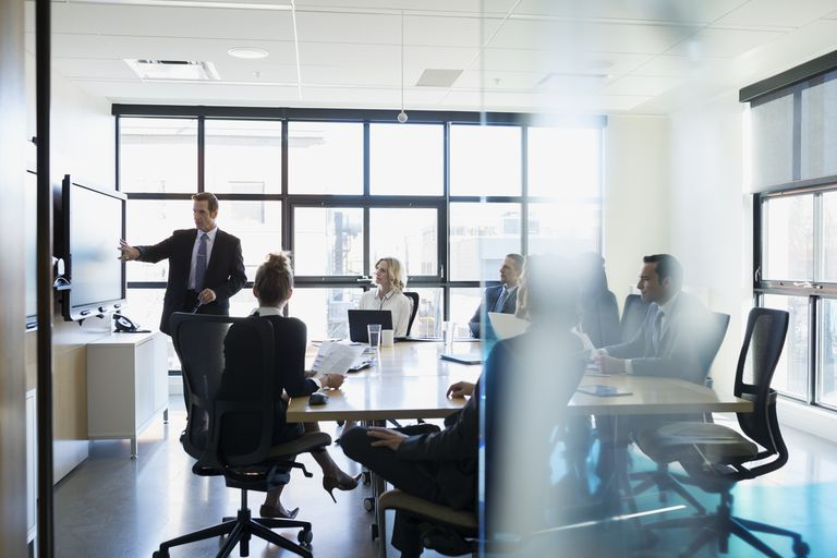 Businessman leading meeting in conference room