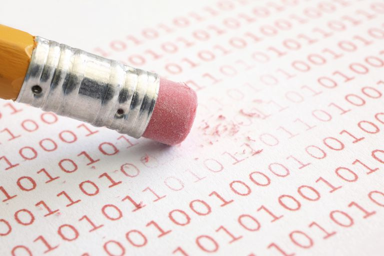 Picture of a pencil erasing binary data
