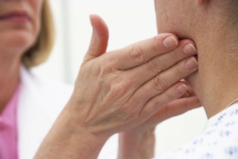 Doctor feeling patient's lymph nodes