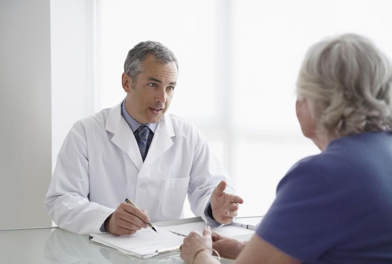 patient talking with a surgeon