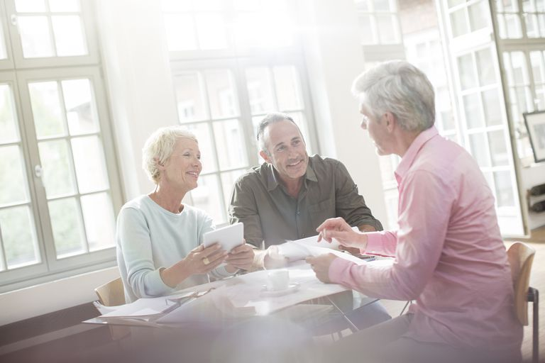 Older couple talking to financial advisor