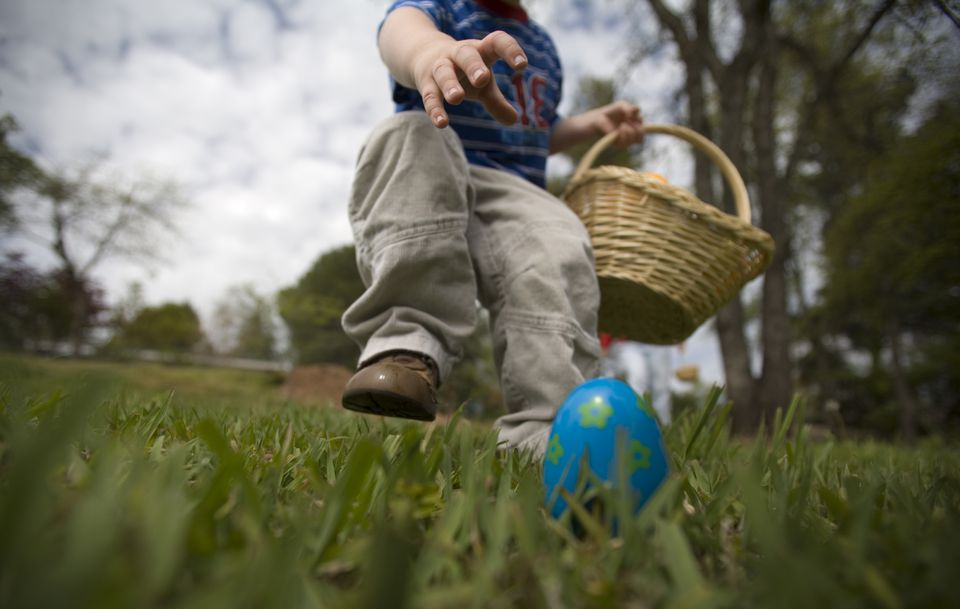 A young boy about to grab an Easter egg,