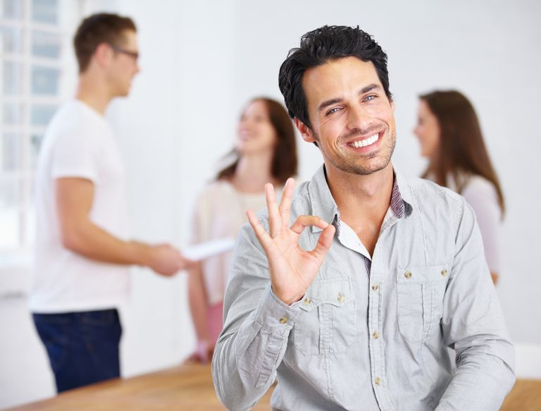 man giving okay hand gesture