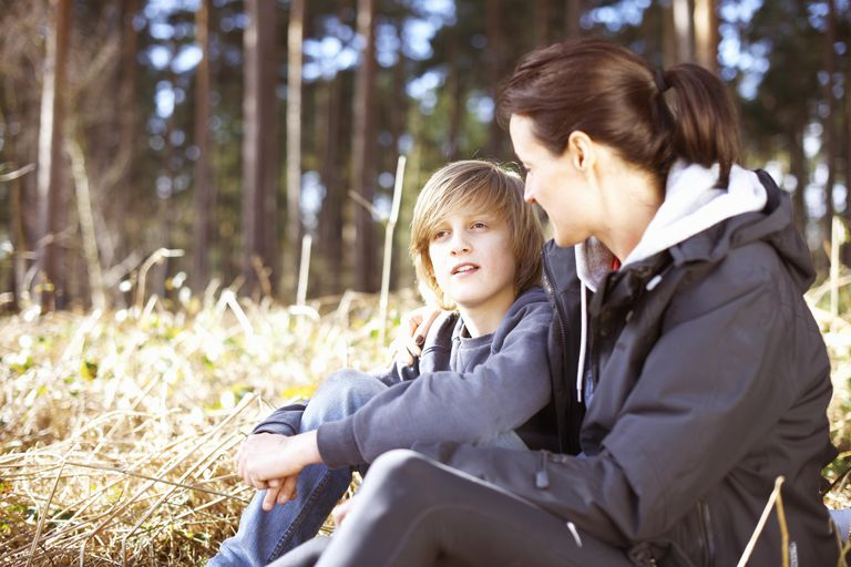 Mature woman taking a break with her son in a forest