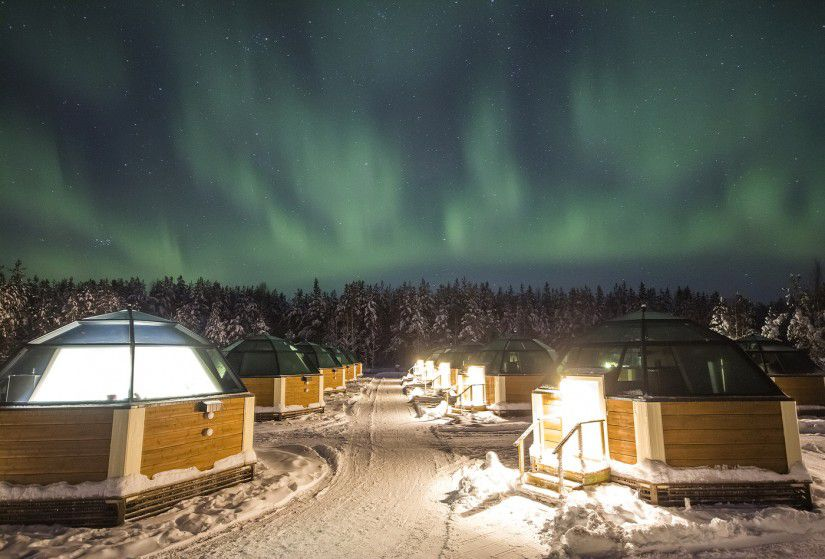 Glass igloos under the Northern Lights at Finland's Arctic Snow Hotel