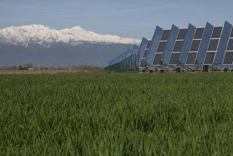 Solar power installation with field & mountains