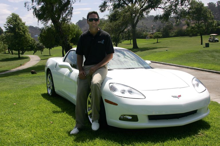 Jimmie Johnson with the hole-in-one prize Corvette at his annual charity golf tournament
