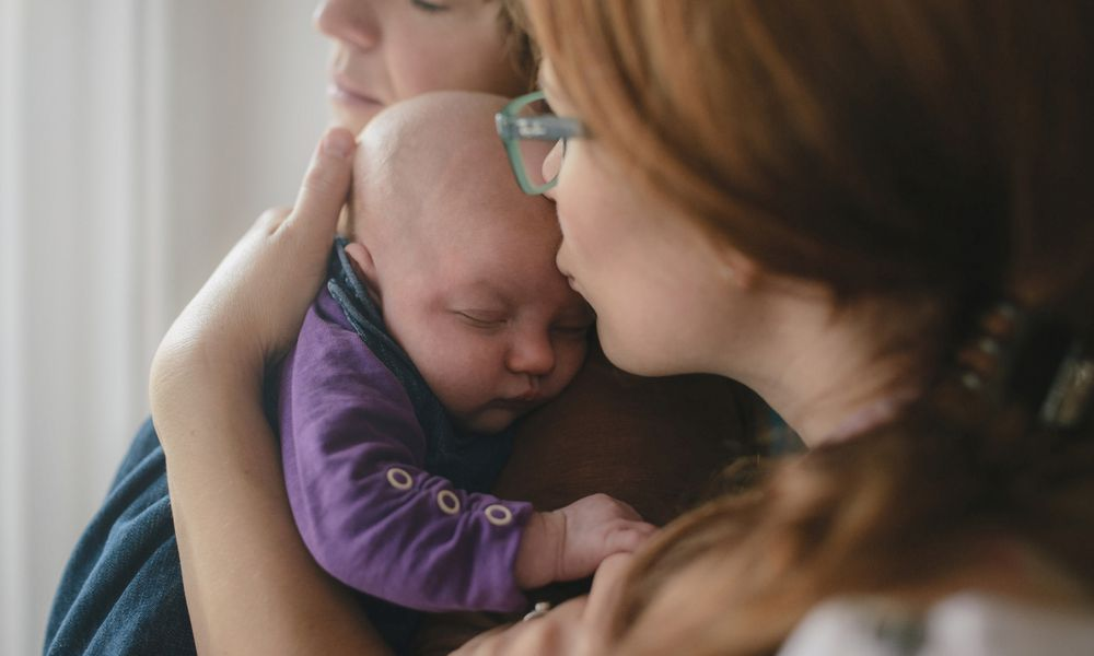 Lesbian couple with newborn baby