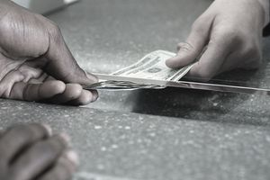Bank teller giving cash to customer