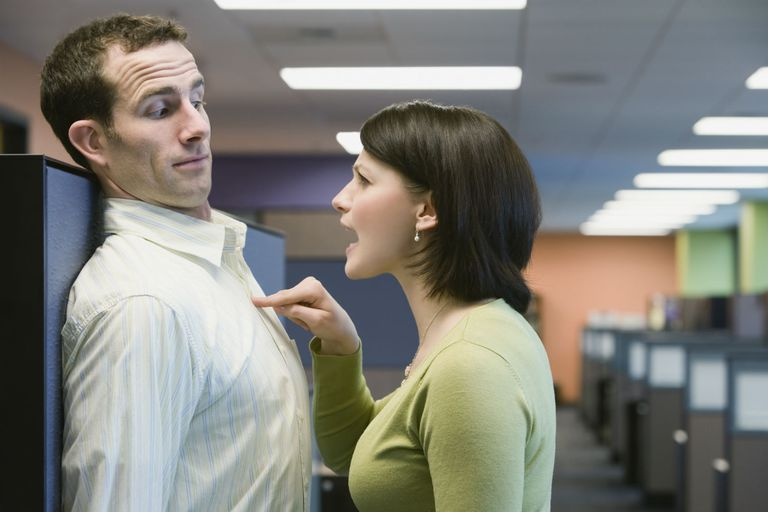 Manager displaying aggressive communication style with employee