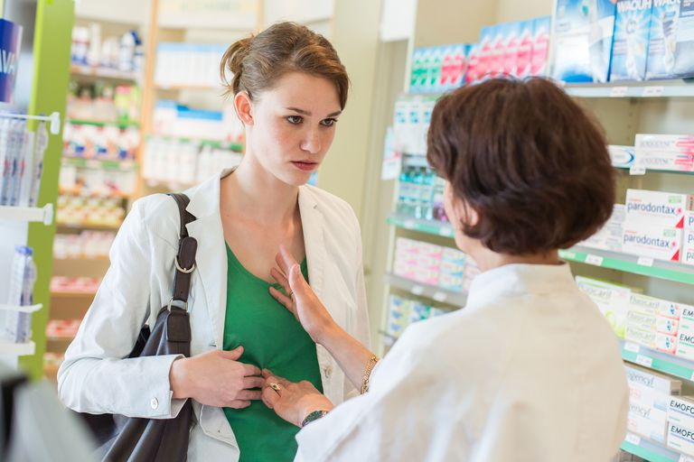 Pharmacy Woman suffering from stomach ache.