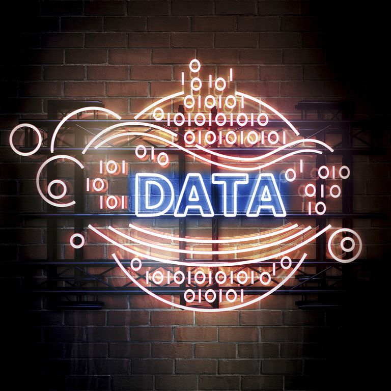 Neon sign that says data with binary symbols