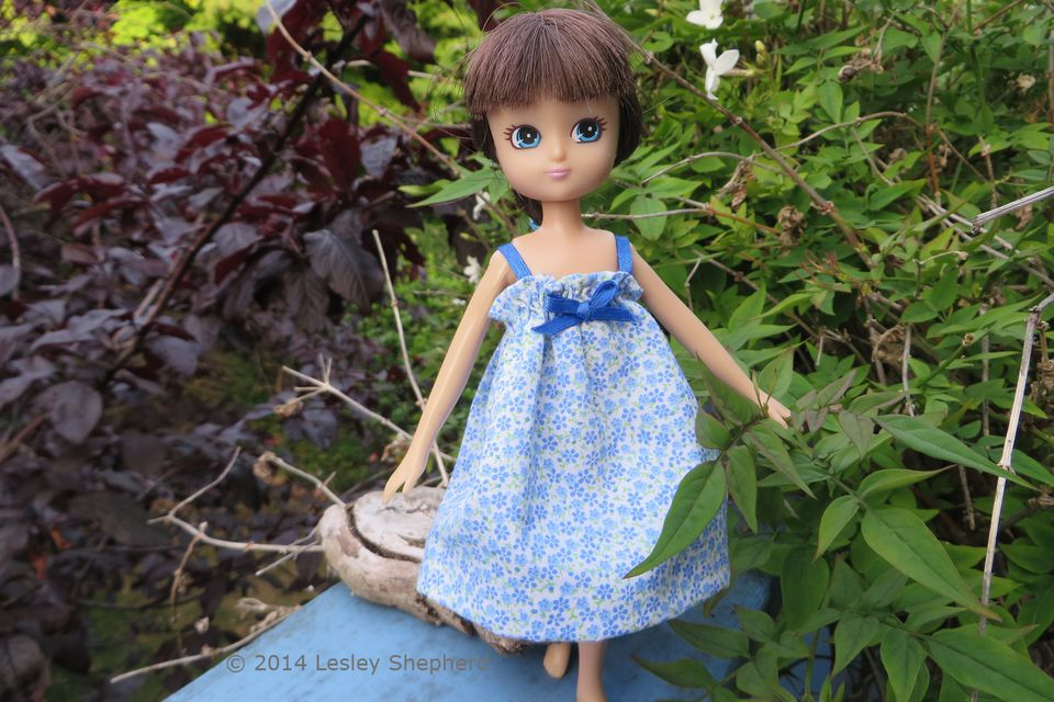 Lottie doll in a simple gathered sundress.